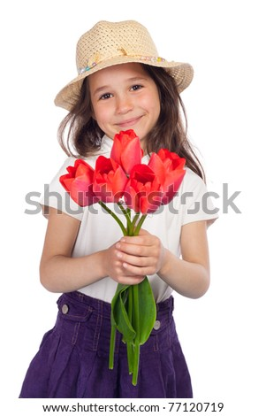 Little girl in straw holding red tulips