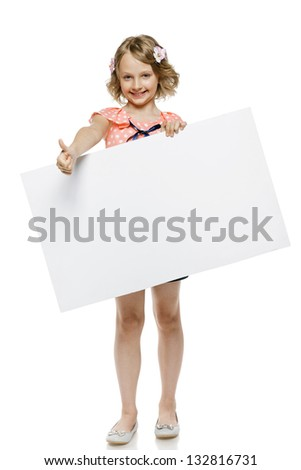 Little girl in summer clothing in full length holding blank whiteboard and showing thumb up sign, isolated on white background - stock photo