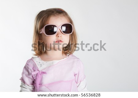 little girl in sunglasses - stock photo