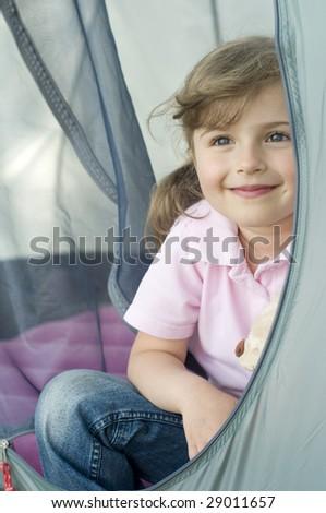 Little girl in tent - stock photo
