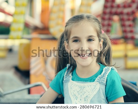 Little girl in the amusement park. - stock photo