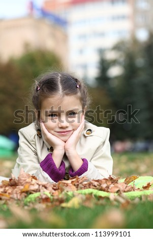 little girl in the autumn park - stock photo