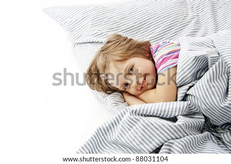 little girl in the bed isolated - stock photo