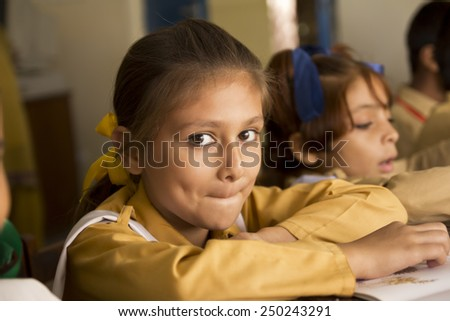 Little Girl in the Classroom - stock photo