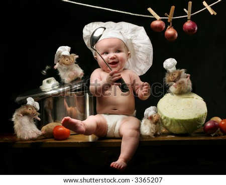 little girl in the cook hat  and hamsters - stock photo