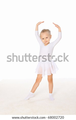 Little girl in the dance pose.