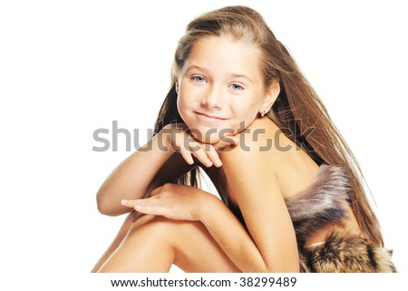 Little girl in the fur as a prehistoric - stock photo