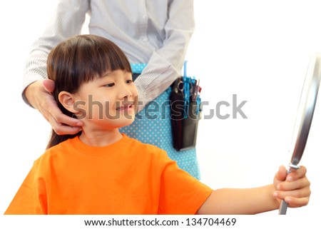 Little girl in the hairdressing saloon