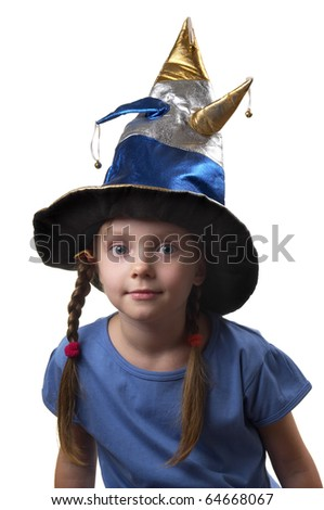 Little girl in the magic witch cap isolated over white background - stock photo