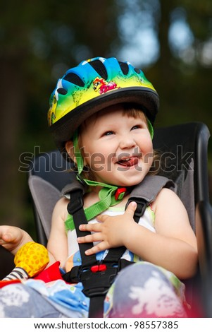 Little girl in the seat bicycle - stock photo