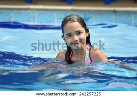Little Girl in the Swimming Pool - stock photo