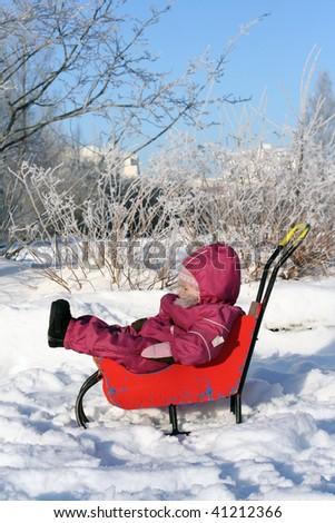 Little girl in the winter park - stock photo