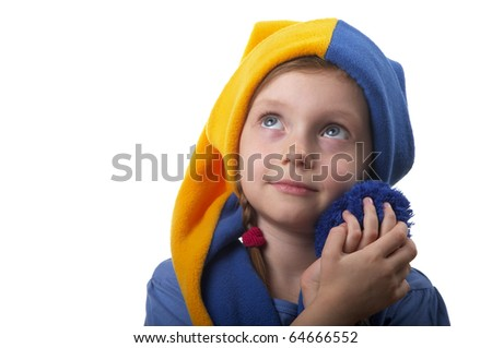 Little girl in the yellow-blue gnome cap isolated over white background - stock photo