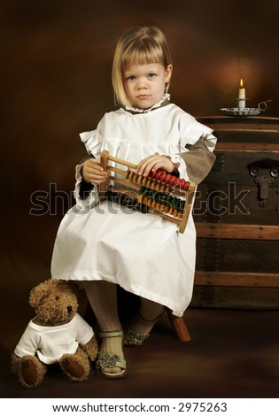 Little girl in vintage victorian portrait, playing with her abacus