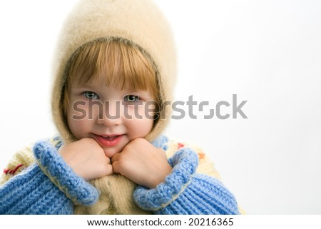 little girl in warm sweater on white background - stock photo