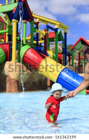 Little girl in water playground - stock photo