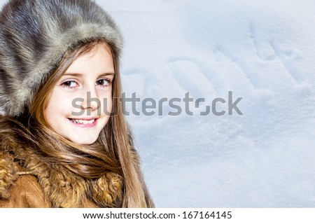 Little girl in winter clothes. Snowy background with 2014 letters - stock photo