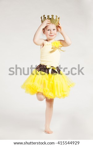 Little girl in yellow - stock photo