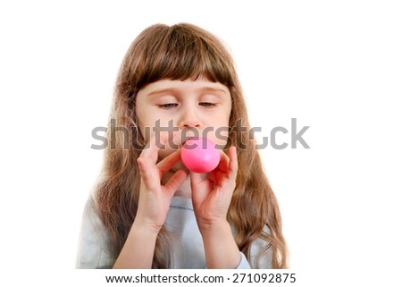 Little Girl inflate a Pink Balloon on the White Background - stock photo