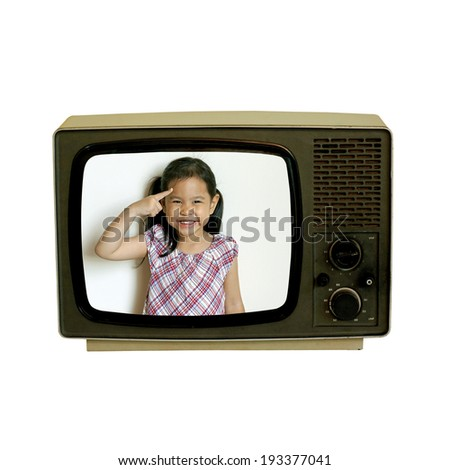 little girl inside old retro television - stock photo