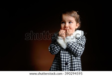 little girl is afraid in darkness - stock photo