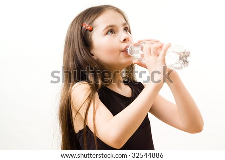 Little girl is drinking water - stock photo