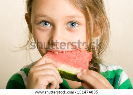 little girl is eating sweet juicy watermelon