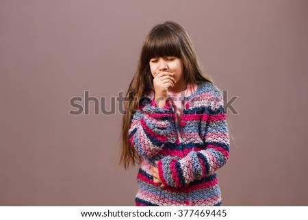 Little girl is having stomachache and she is going to vomit.I am sick! - stock photo