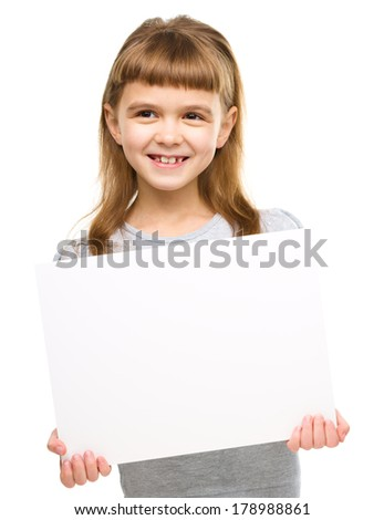 Little girl is holding blank banner, isolated over white - stock photo