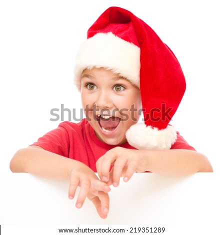Little girl is holding blank board and looks impressed by something, isolated over white - stock photo