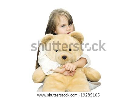 Little girl is hugging big  teddy bear - stock photo