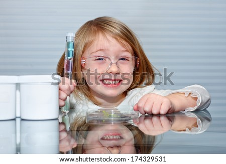 Little girl is making science experiments