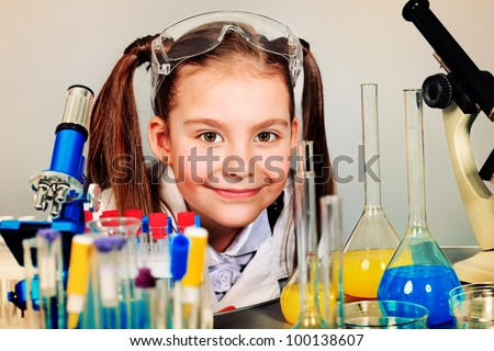Little girl is making science experiments. Education.
