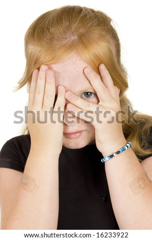 little girl is peaking through her fingers - stock photo