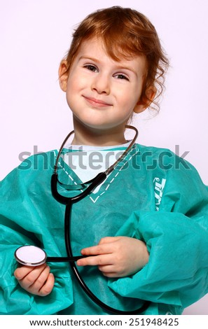 Little girl is playing doctor, isolated over white - stock photo