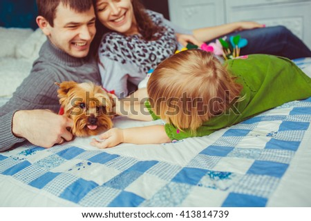 Little girl is playing with a cute dog