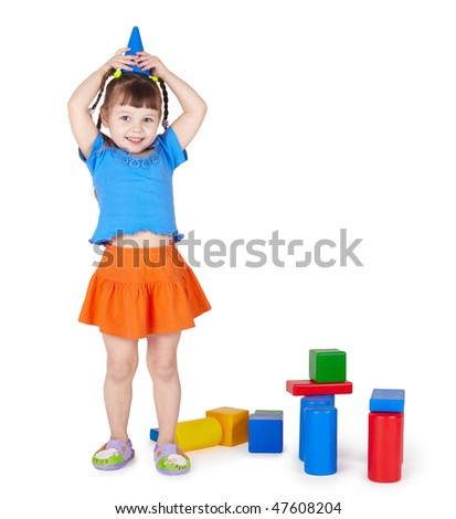 Little girl is playing with colored blocks on a white background - stock photo