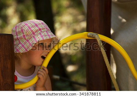 Little girl is pondering over - stock photo