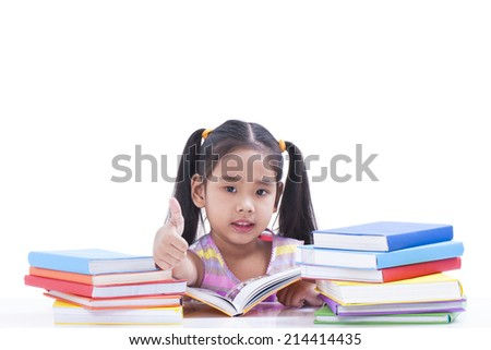 Little girl is reading book and showing thumb up.