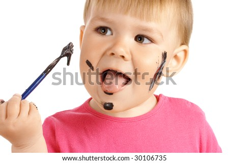 Little girl is ready to eat black paint from paintbrush, isolated over white