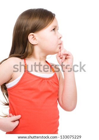 Little girl is showing hush gesture, isolated over white - stock photo