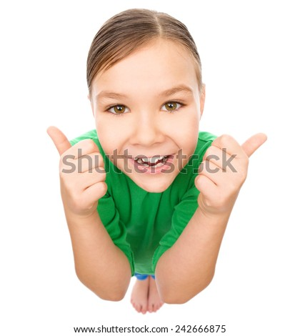 Little girl is showing thumb up gesture using both hands, fisheye portrait, isolated over white - stock photo