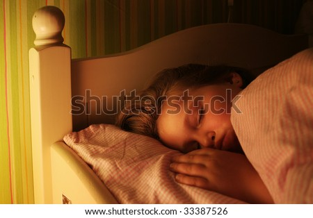 Little girl is sleeping well in her bed - stock photo