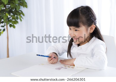little girl is studying in house - stock photo