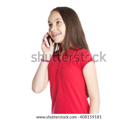 Little girl is talking on phone   - stock photo