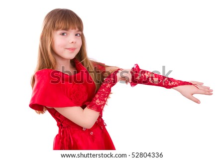 Little girl is wearing red dress and gloves. Close-up portrait of a beautiful blond girl. - stock photo