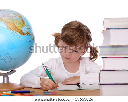 Little girl is writing in a notebook. - stock photo