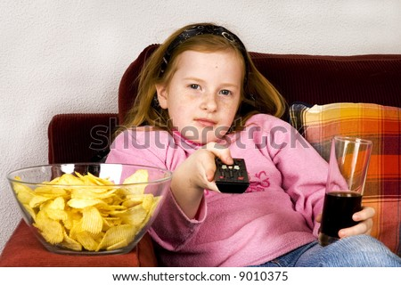 little girl is zapping TV - stock photo