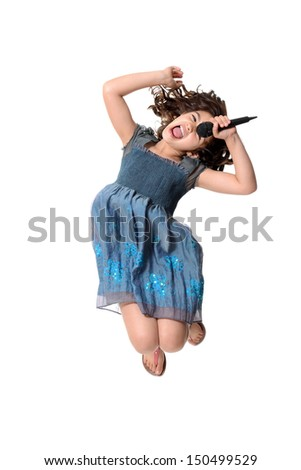 little girl jumping and singing - stock photo