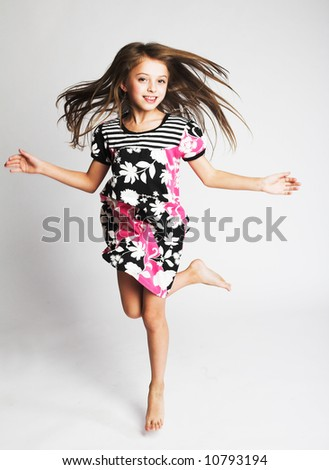 little girl jumping of joy - stock photo